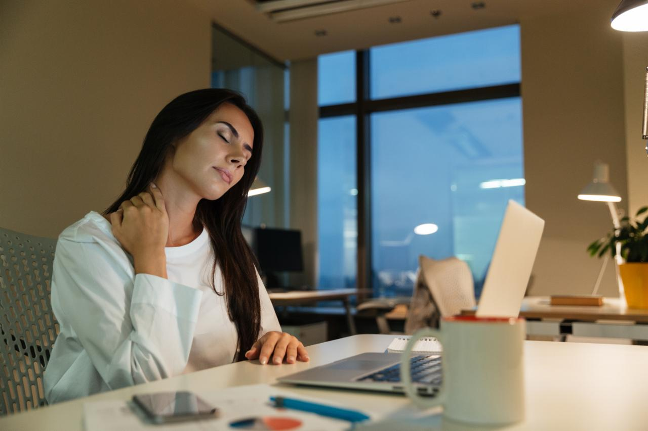 graphicstock-tired-fatigued-young-businesswoman-sitting-and-working-in-office_S87e2sw7_3g